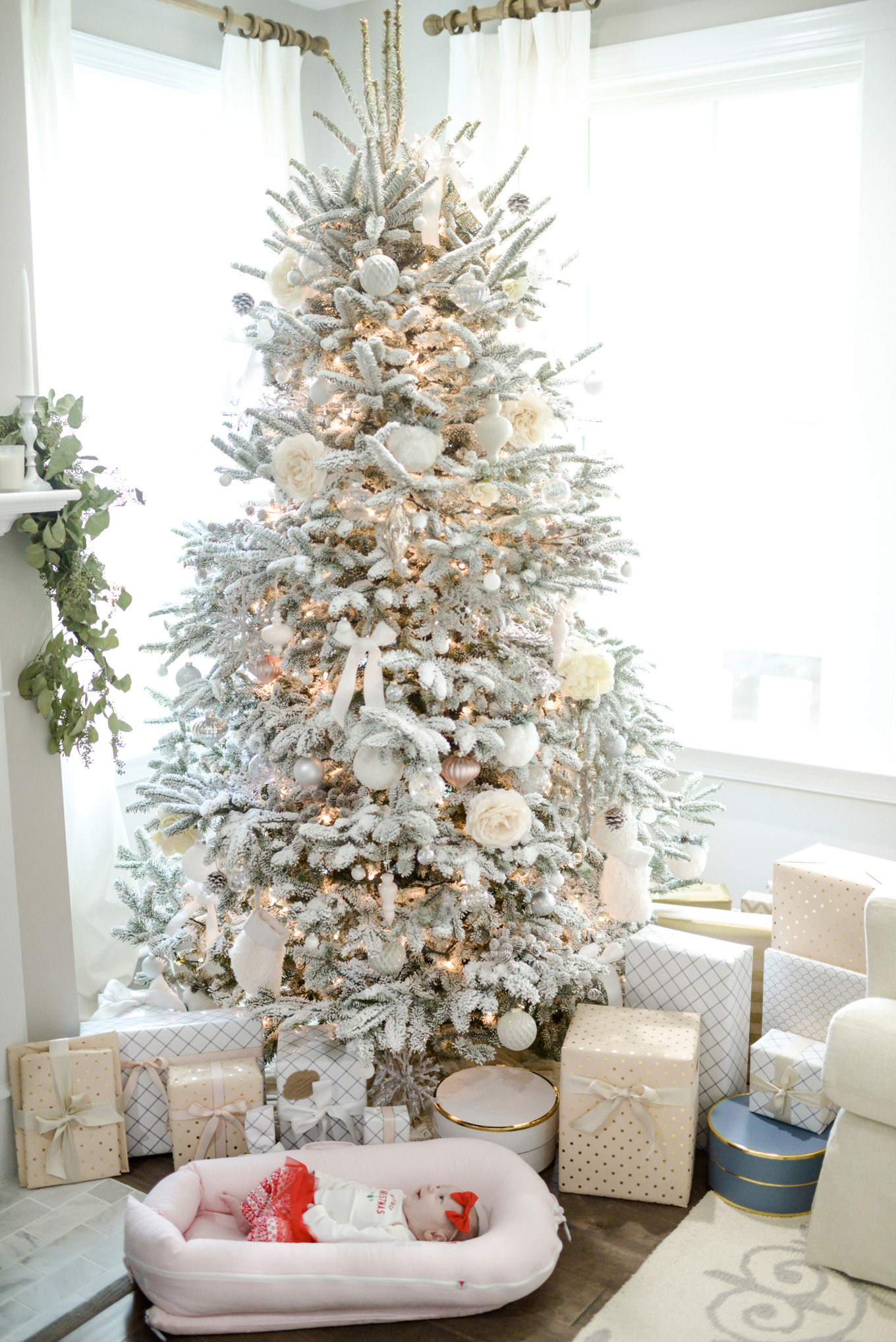 A baby and presents | Lifestyle Blogger Elle Bowes shares holiday home decor ideas.