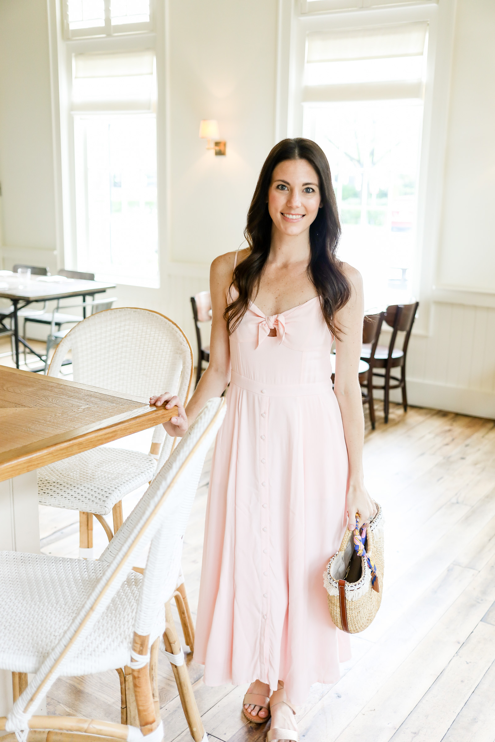 pink bow tie front dress by yumi kim | pink dress | straw tote | pink midi dress | every day joie by elle bowes