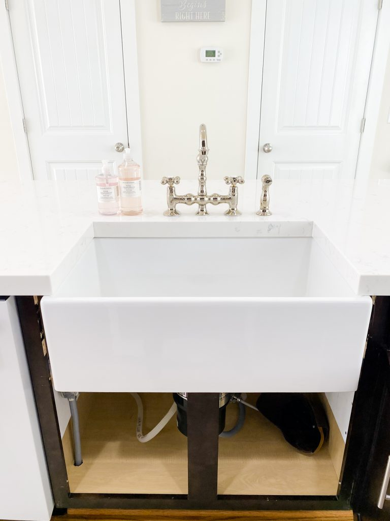 farm sink with bridge faucet