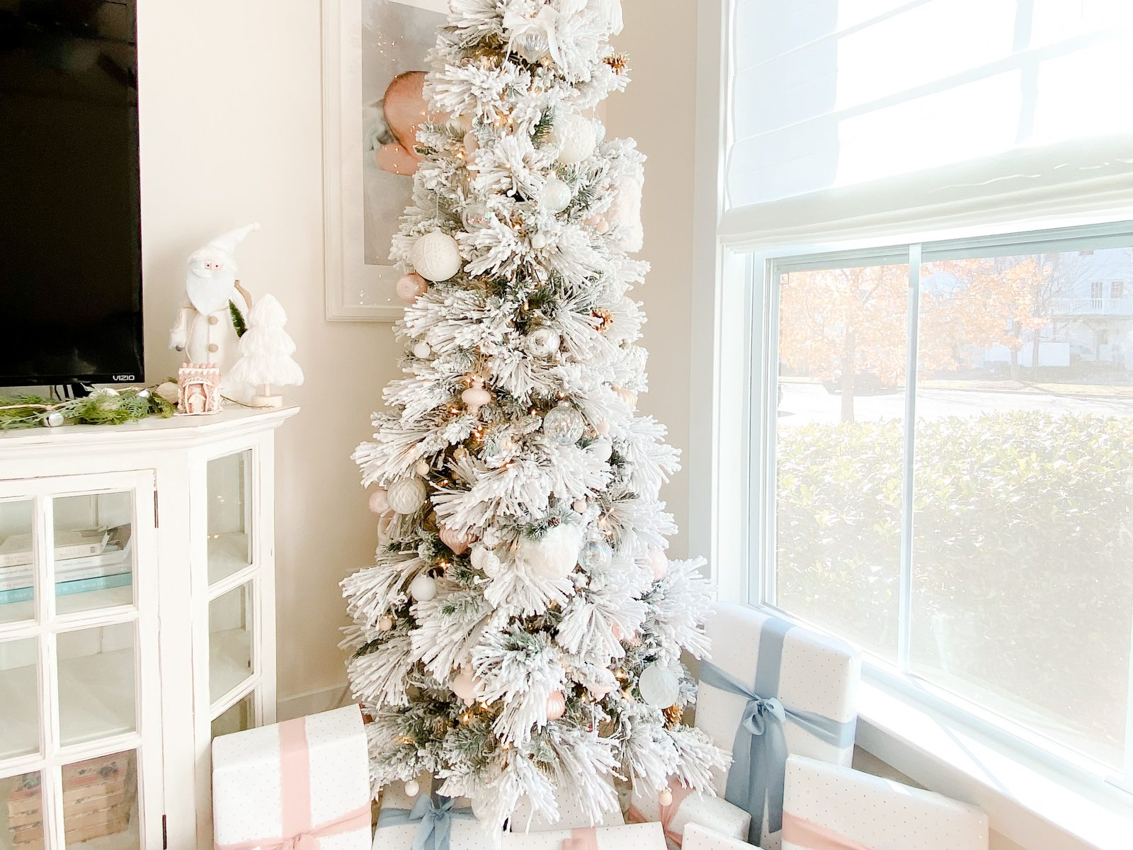 flocked Christmas tree, white Christmas tree, snow, Christmas decor, white tree with ornaments, Christmas presents